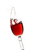 Splashing glass of red wine Stock Photography