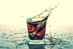 Splashing in glass with soda, ice cubes, white background Royalty Free Stock Photo