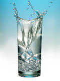 Splashing glass of water Stock Images