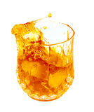 Splashing golden liquor(whisky,rum,bourbon) Stock Photo