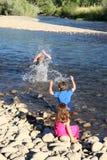 Splashing kids Royalty Free Stock Photos