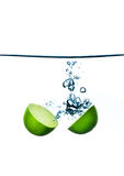 Splashing kiwi. HQ studio shot Royalty Free Stock Photography