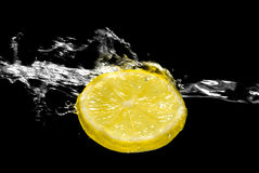 Splashing lemon Royalty Free Stock Photo