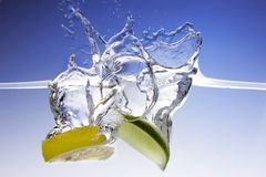 Splashing Lemon and Lime Royalty Free Stock Image