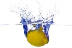 Splashing lemon into a water Stock Photos