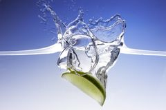 Splashing lime Royalty Free Stock Image