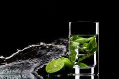 Splashing limes royalty free stock photography