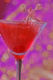 Splashing manhatten. Manhatten with a cherry splash shot Royalty Free Stock Image