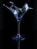 Splashing martini glass stock image