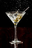 Splashing martini olives Royalty Free Stock Image