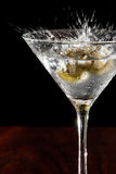 Splashing martini olives Royalty Free Stock Photography