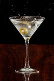 Splashing martini olives Stock Photos