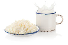 Splashing milk and cottage cheese Stock Photo