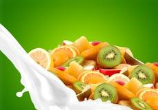 Splashing milk with fruit mix Stock Photo