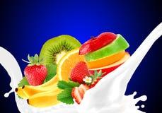 Splashing milk with fruit mix Royalty Free Stock Photo