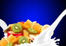 Splashing milk with fruit mix Stock Photos