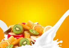 Splashing milk with fruit mix Royalty Free Stock Photos