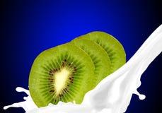 Splashing milk with kiwi Stock Photography