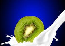 Splashing milk with kiwi Royalty Free Stock Photography
