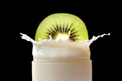 Splashing milk with kiwi Stock Image