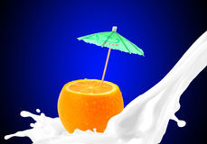 Splashing milk with orange Stock Images