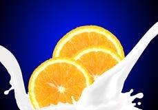 Splashing milk with orange Stock Photo
