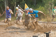 Splashing through the mud mines Stock Photography