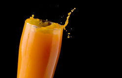 Splashing orange juice Stock Photo