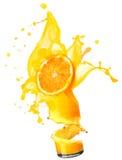 Splashing orange juice with oranges Royalty Free Stock Photos