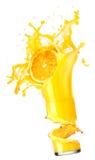 Splashing orange juice with oranges Stock Photo
