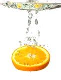 Splashing orange in water. White background Stock Photo