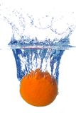 Splashing orange into a water Stock Image