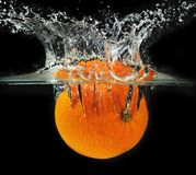 Splashing orange into a water Royalty Free Stock Photo