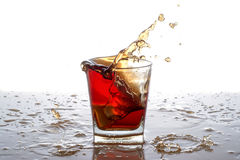 Splashing out of the glass from falling ice Royalty Free Stock Photography