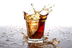 Splashing out of the glass from falling ice Royalty Free Stock Image