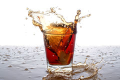 Splashing out of the glass from falling ice Stock Photo