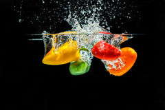 Splashing Paprika Stock Images