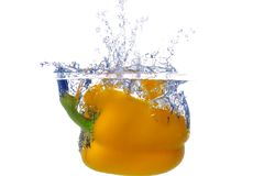 Splashing peper into a water Stock Photos