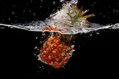 Splashing  pineapple Stock Image