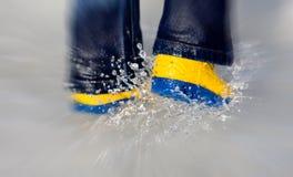 Splashing in puddle Stock Image
