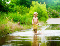 Splashing in a puddle Royalty Free Stock Photography