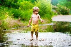 Splashing in a puddle Royalty Free Stock Photo