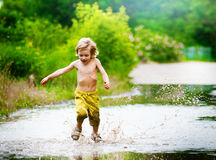 Splashing in a puddle Royalty Free Stock Image