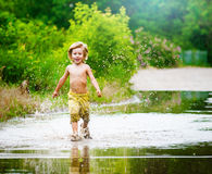 Splashing in a puddle Stock Image