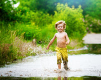 Splashing in a puddle Royalty Free Stock Photos