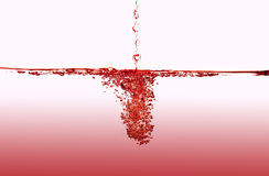 Splashing red water. Cold water splash. Isolated in white background Stock Photo