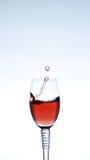 Splashing red wine Stock Photography