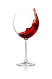 Splashing red wine in a glass Royalty Free Stock Images