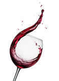 Splashing red wine. Glass of splashing red wine isolated on white royalty free stock photos