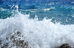 Splashing sea wave Stock Images